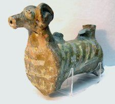Aquamanile in form of ram; Lyveden-type Ware; decorated with applied strips of slip decoration.
