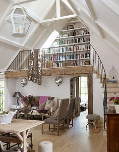 The wrought iron, the two stories, the beams, the books. This room is fabulous!