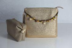 borsa e pochette in paglia e pelle realizzati a mano