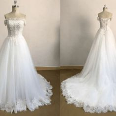 This off the shoulder bridal gown has a pretty lace up back. Get custom #weddinggowns made to order with any change you need with our company. Replicas are also an option for brides who love a couture design but are on a budget.  Just email us pictures for pricing from our site.