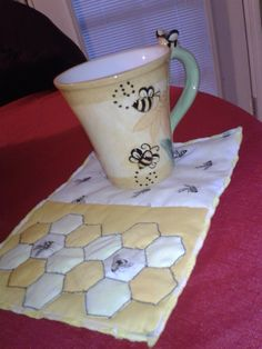 This little Bee Mug Rug is for a quilting bee friend. I used the serger for the binding edges.