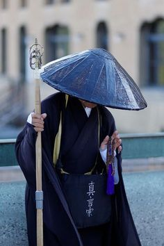 Japanese ascetic monk ( I saw some with begging bowls standing in Tokyo train stations from time to time, or walking very very slowly to the station)
