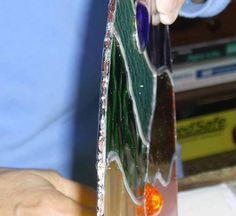 How to hang stain glass panel with wire by adding wire to the edge for hanging.