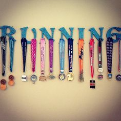 What a cool idea!!!!!   Athletic & Race Medal Hanger Wood Letters RUN by GloriPearlDesigns... Need to do this!