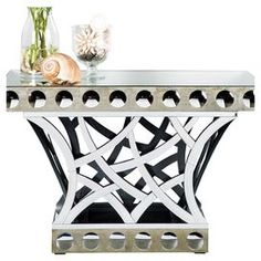 """Mirrored console table with an openwork base.  Product: Console tableConstruction Material: Mirrored glass and woodColor: SilverDimensions: 31.5"""" H x 47.5"""" W x 24"""" DNote: Accents pictured are not included"""
