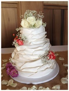 Wrapped ruffle wedding cake by frosted fantasies cakes, WV.