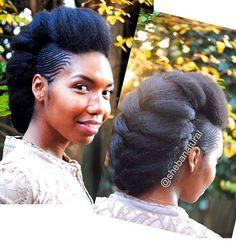 Tresse africaine unique sur cheveux crépus afro pour les fêtes.