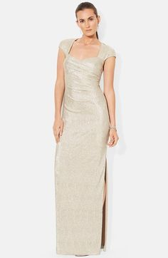 A soft metallic finish brings a romantic glow to a lithe column gown detailed with a striking back cutout for a glamorous finish.
