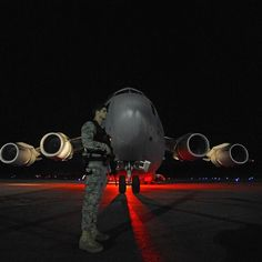 #Repost @philippetondeur  U.S. Air Force Airman 1st Class Ryan Merriman a member of a 437th Security Forces fly away security team provides security for a U.S. Air Force C-17 Globemaster III aircraft and its crew as earthquake relief supplies are off loaded January 16 2010 at Port-Au-Prince airport Haiti. Photo by Staff Sgt. Jason Robertson. by militarytopics