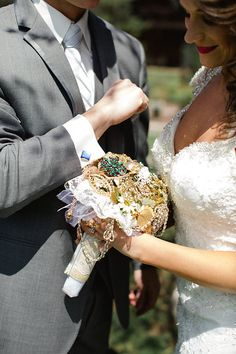 Brooch bouquet from grandmothers pins and grooms cuff links are grandfathers. Photo from Taryn + Dan collection by Jordan DeNike Photography