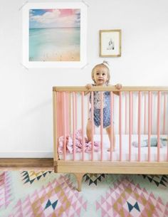 Em Scott, a designer in San Francsico, never dreamed she'd base her daughter Charlie's nursery on the color pink. Then she came across this rosy crib and ended up decorating around its blushing loveliness.
