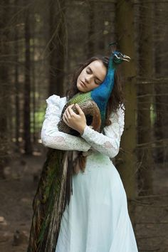 In a Wonderland They Lie… - She is the goddess of the forest, a mythological creature of great kindness and beauty. Her gaze is steady, mesmerizing...