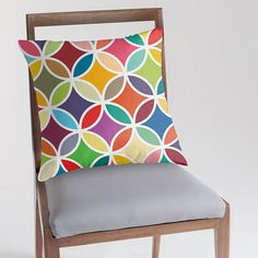 Retro pillow cover with colourful flower petals by JAYSANSTUDIO