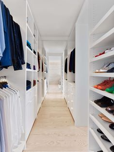 This modern walk-in closet as wide-plank Douglas Fir flooring and plenty of floor-to-ceiling shelving space. Walk In Closet Design, Closet Designs, Glen Park, Black And White Tiles, Small Closets, Modern Masters, Wide Plank, Patio, New Homes