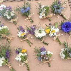 Pretty wildflower meadow buttonholes finished with raffia, for an early Summer wedding                                                                                                                                                     More