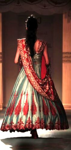 Colors. I would have loved this if the poof started off a bit more gradually. I like the draped dupatta and the work on the bottom half though.