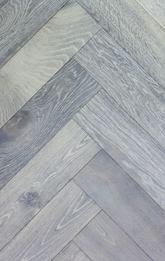 SILVER WHITE. Herringbone parquet flooring. Slightly brushed mixed White and Grey shade excellent choice for modern property. Parquet flooring samples sent daily free of charge. Wood Flooring With Style Commercial and Residential projects