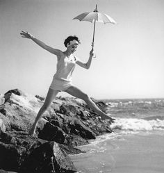 Sondra Peterson in one-piece bathing suit designed by Elisabeth Stewart photo by Herman Landshoff, 1958