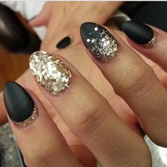 Matte black almond shaped false nails with gold glitter detailing - these can be done in stiletto or square shape also come with nail glue!