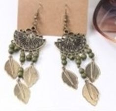 embellished beaded leaf earrings $7.95