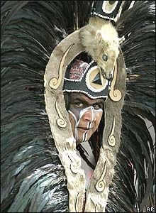 Performer in Aztec clothing, for the Dance of the Four Winds