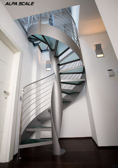 Round-section painted steel spiral staircase