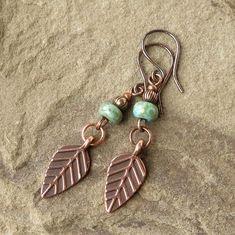 Leaf dangle earrings - stylized antiqued copper leaves are suspended below mottled turquoise blue Czech glass beads. A few additional antiqued copper embellishments complete the 2 dangle, which includes the handcrafted copper ear wires. See my third image for an accurate illustration of