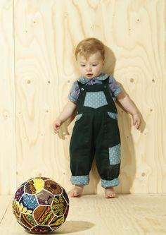 Limited Edition Dungarees In Forest Green 42.00 Forest green with blue spot contrast pattern detail  Fabulous easy wearing dungarees for kids in our vintage inspired bold prints. Limited edition with lots of cool detail.  3 contrast pocket dungaree with matching contrast turn ups. Bottoned straps make it an easy item to slip on and off too. These complete the ideal bright summer wardrobe or can be layered for spring or autumn.  Why not pair with one of our unisex neckerchiefs for children…