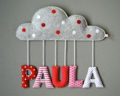 This wonderful nursery decoration is a perfect gift for birth, baby shower or baptism. Fabric letters fixed on a cute cloud made of woolen felt are made of nice colorful cotton fabrics and filled with soft padding. It´s suitable for names up to 6 letters Felt Crafts, Diy And Crafts, Name Decorations, Fabric Letters, Diy Bebe, Birth Gift, Diy Garland, Christening Gifts, Little Star