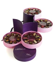 Exotic Caramel Collection - 4 Tier Hatbox is $74 but will be sure to make a statement. The presentation is wonderful and the taste delicious and unique!