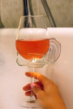 And the ultimate bathroom accessory: A cupholder for your bath wine or shower beer. | 23 Things You Didn't Know You Needed For Your Bathroom