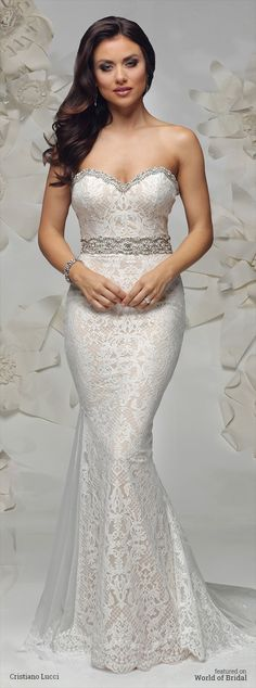 This bold patterns of dramatic lace featured in this romantic fit and flare gown, finished with intricate beadling along neckline and waist.