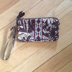 "SALE Vera Bradley Brown Toile Wristlet Vera Bradley Brown Toile Wristlet w/ pink accent on front. 1 interior pocket. 7.24"" long X 4"" tall. In good used condition, no stains or flaws. Vera Bradley Bags Clutches & Wristlets"