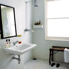 Wet room - mirror and sink love plus have bench in shower area