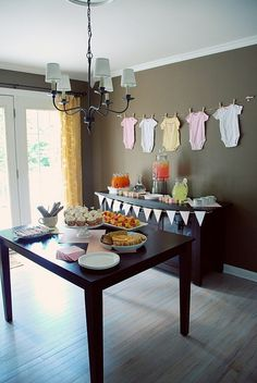 I love the idea of hanging onezies on a clothes line for baby shower decor!