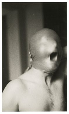 Gerhard Richter B.1932 UNTITLED (SELF PORTRAIT WITH MASK) signed and dated 71 on the reverse gelatin silver print 17.3 by 10.6cm.; 6 7/8 by 4 1/8 in.