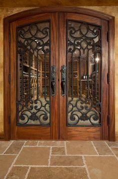 Love these doors. The doors to the wine cellar are mahogany, like the front door, but have iron panels in an intricate design. Iron Front Door, Double Front Doors, Wrought Iron Doors, Wrought Iron Staircase, Front Door Design, Unique Doors, Beautiful Front Doors, Front Entrances, Entrance Doors