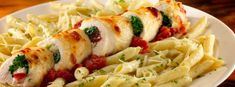 Chicken Spinoccoli is an Uno's Classic: A rolled chicken breast filled with mozzarella, feta, broccoli, spinach, tomatoes, garlic & basil with penne in creamy pesto & chunky tomato sauce