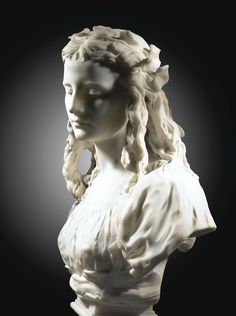 Jean-Baptiste Carpeaux: LA CANDEUR, MARBLE BUST, SIGNED AND DATED, ON A RED MARBLE BASE Haut. 66 cm Height 26 in 1873 Sotheby's