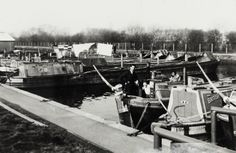 BW192-3-2-2-13-1-581Mitchell family and narrowboats at a lay-by at Bulls Bridge on the Grand Union Canal Description Black and white photograph showing Syd and Eleanor Mitchell on the British Waterways butty 'Lyra'. There are other narrowboats shown including the butty 'Bordesley' and the motors 'Darley' and 'Yeoford'. Date 1960