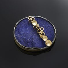 "MARGARET DITTRICH-USA ""From pearls to pebbles, sapphires to meteorites and with gold married to silver, Margaret Dittrich uses a wide variety of components to create her jewelry"""