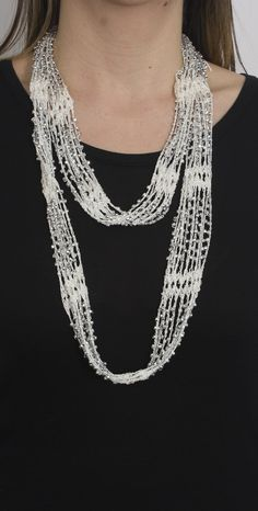 Crochet Beaded Necklace Scarf with Silver Beads Give your accessory game a facelift with our crochet beaded necklace scarves which bring together two of your favorites! As a great alternative to a necklace, these jewelry scarves will transform a si Crochet Beaded Necklace, Yarn Necklace, Knitted Necklace, Crochet Bracelet, Scarf Jewelry, Fabric Jewelry, Bead Crochet, Beaded Jewelry, Diy Accessories