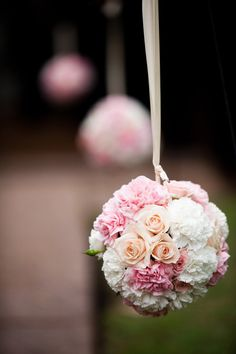 Pretty balls of flowers as wedding aisle decorations. // Flowers by Floriginality // Photo by Deep Grey Photography