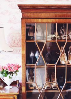 My shoe cabinet is actually a mahogany bow front china cabinet we discovered at the Saturday morning antiques auction. It was the very first thing we had ever bid on; paintings and ginger jars and old maps of London would follow, but this particular piece will always have an extra special place because it was the first.  Roséline Lohr, founder and editor in chief of This is Glamorous,