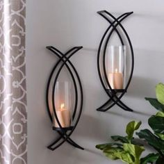 """Charlie Crisscross Sconces, Set of 2 Want to give your living space a twist? Try our """"Charlie Crisscross Sconces!"""" After All, the best things in life come in pairs. Metal Walls, Wall Decor Living Room, Decor, Wall Decor, Wall Candles, Wall Sconces Living Room, Candle Wall Sconces, Wall Candle Holders, Iron Decor"""
