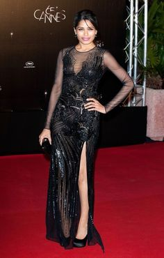 Freida also made a quick change for the festival's opening night dinner event. The gorgeous actress wore this sparkling Versace gown featuring a daring thigh high slit. She added black satin pumps and a black clutch to complete her sensational look.