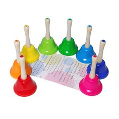 Rainbow Hand Bells - A beautiful set of hand bells specially designed for children. Each bell is differentiated by colour sounds one note of the octave. Gives children an opportunity to enjoy playing music together. 8 hand bells and a music sheet with notes specifying the colour of the bell to be rung. Great for encouraging interaction and teamwork.