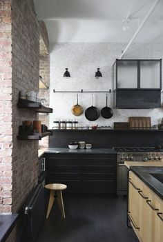 open kitchen shelves on exposed brick