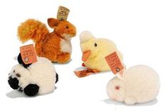 TWO STEIFF POM-POM RABBITS, DUCK AND SQUIRREL: Rabbit, (2504,1), white; Rabbit, (2504,4), white and black; Duck, (2504), all three with FF buttons and red cloth tags, 1931-43 --2in. (5cm.) long; and Squirrel, (3506), FF button with cream paper tag, 1933-41 --2in. (5cm.) high (4)