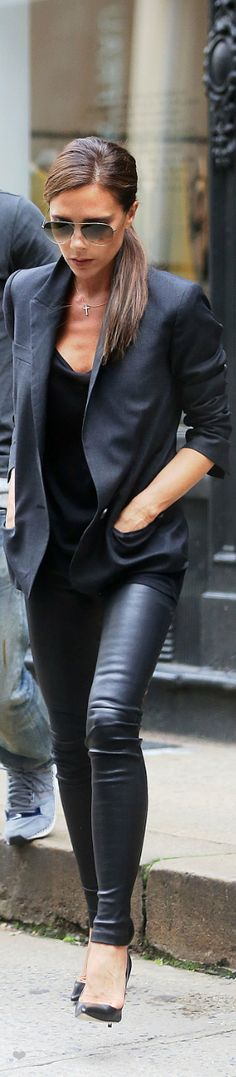 Victoria Beckham's lookin' sharp -- I'm particularly intrigued by her leather-and-crucifix combination.